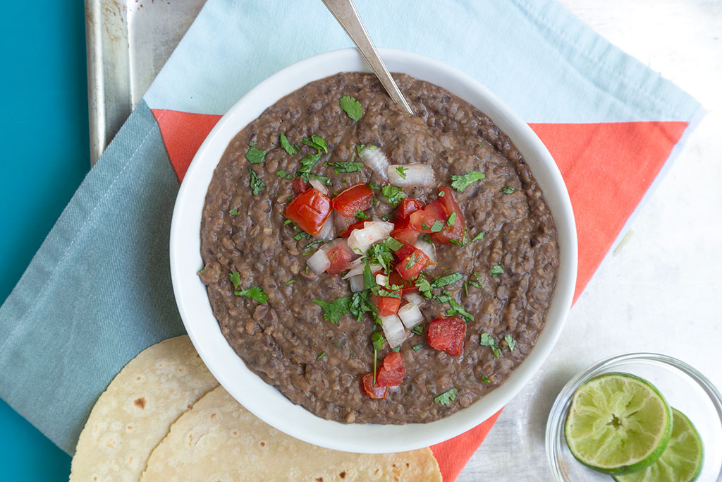 Black Bean Dip topped with tomatoes and onions