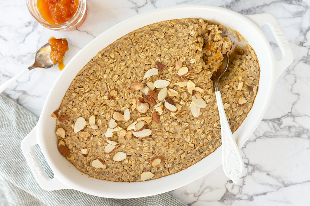 Almond Croissant Baked Oatmeal in a white oval ceramic dish