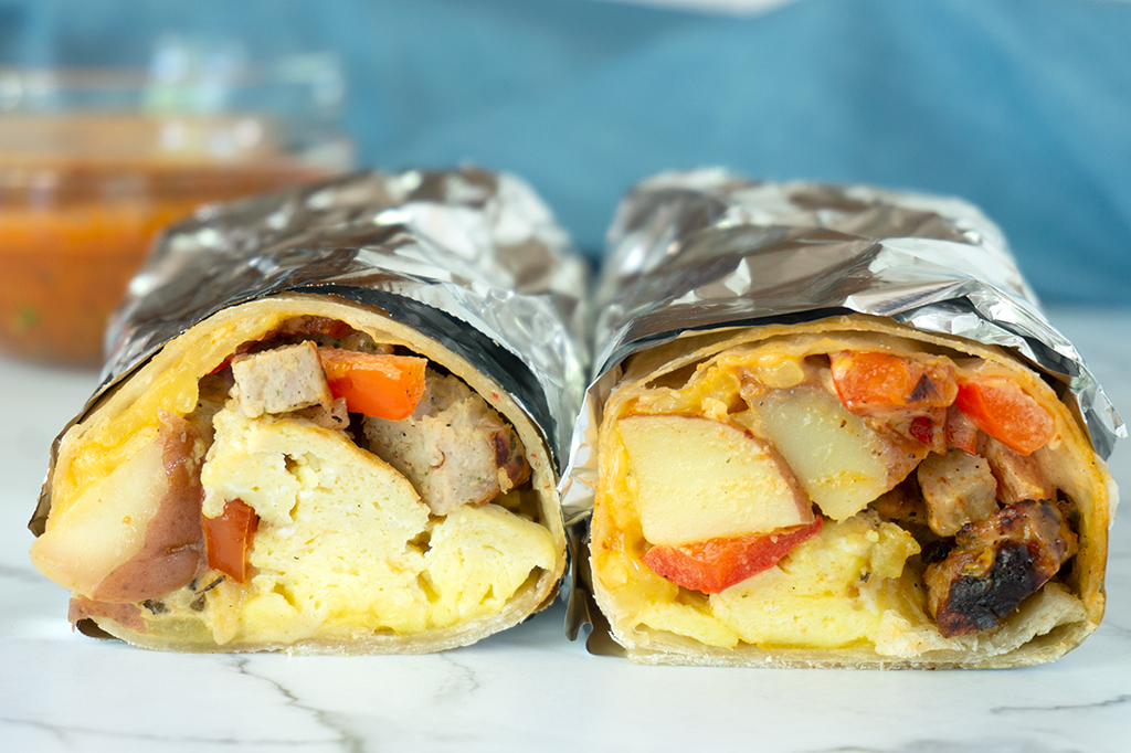 two breakfast burritos wrapped in foil