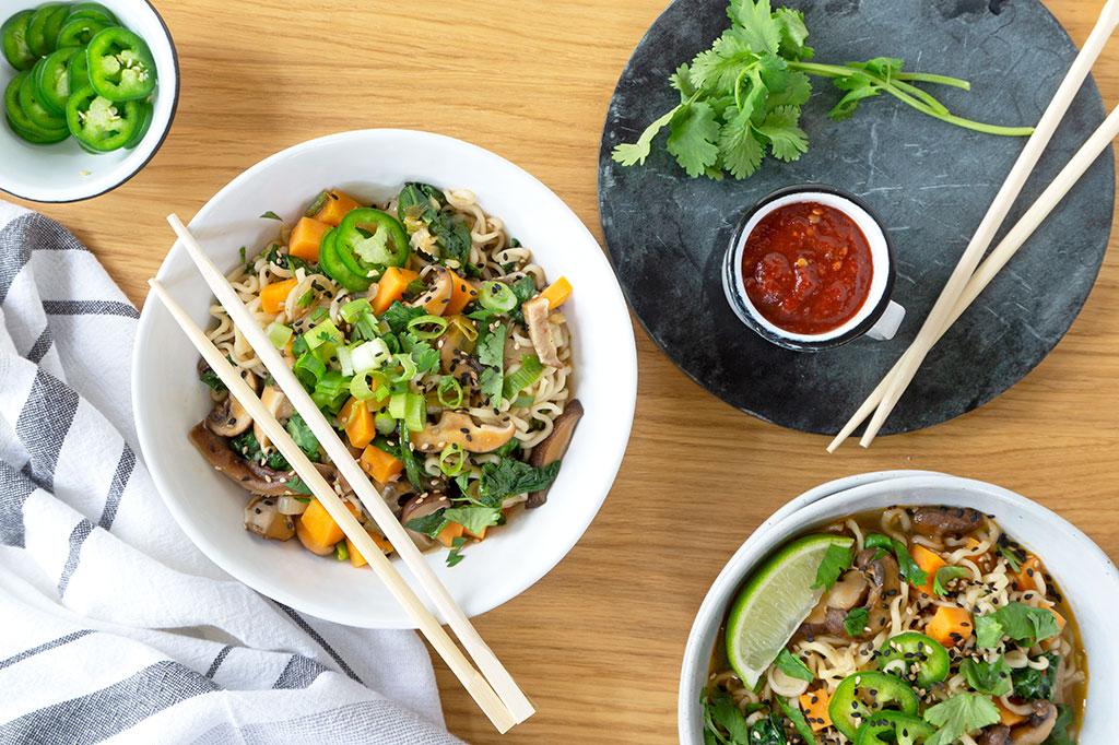 bowls of noodles and chopsticks