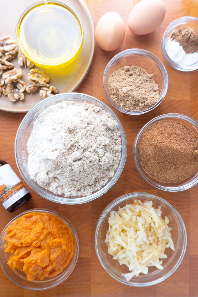 whole wheat pumpkin muffin ingredients in bowls